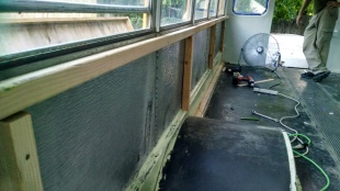 Building up the walls. We added foam insulation to the interior walls.